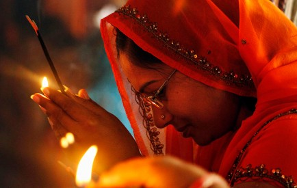 A Hindu woman holds incense sticks as she offers prayers inside the Alopi Devi temple in Allahabad. Hindu New Year is celebrated Friday, the first day of Navratri, or nine nights festival that honors Hindu goddess of valor, Durga.