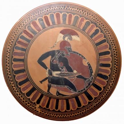 A Crouching Black Greek Hoplite warrior using the Xiphos sword.