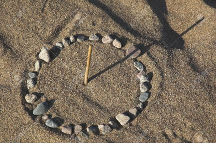 sundial on sea sand